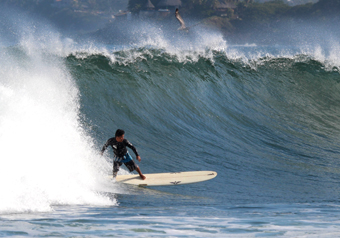 surfing big waves in Sayulita