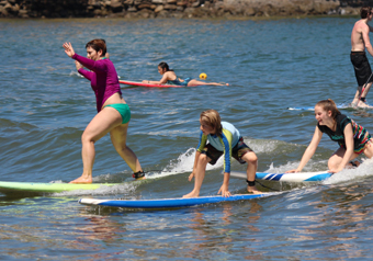 a family enjoys Sayulita surf lessons