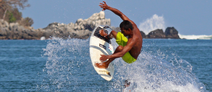 a sayulita surfer catches some air. photo by wicked fotos sayulita
