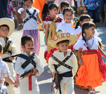 smiling children in traditional Mexican costume