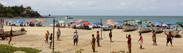 sayulita's south beach with fishing boats and volleyball players